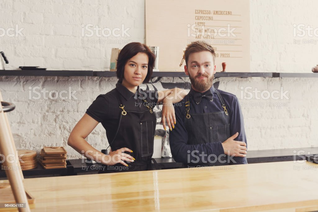 Male and female bartenders in cafe uniform royalty-free stock photo