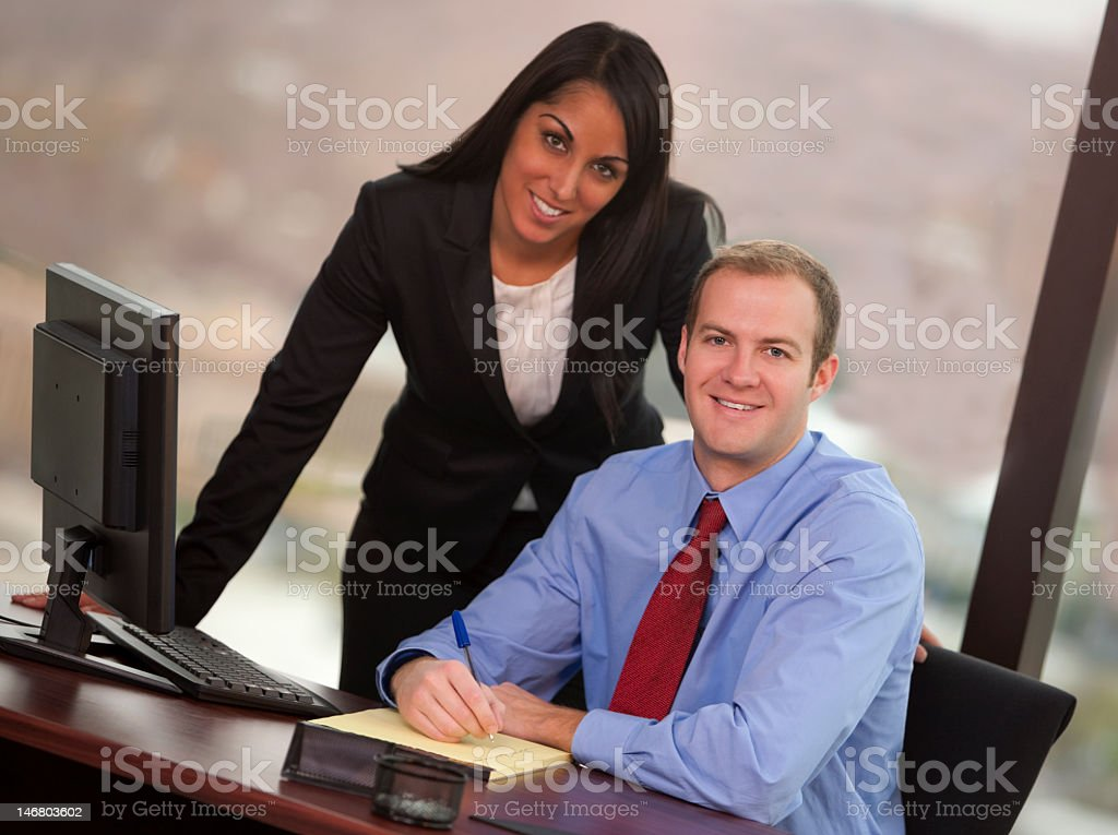 Male And Female Business People In Office royalty-free stock photo