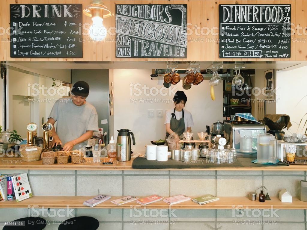 Male and female chefs preparing for lunch service in Cafe stock photo