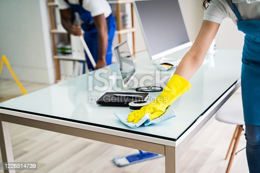 istock Male And Female Cleaners Cleaning Office 1226514739