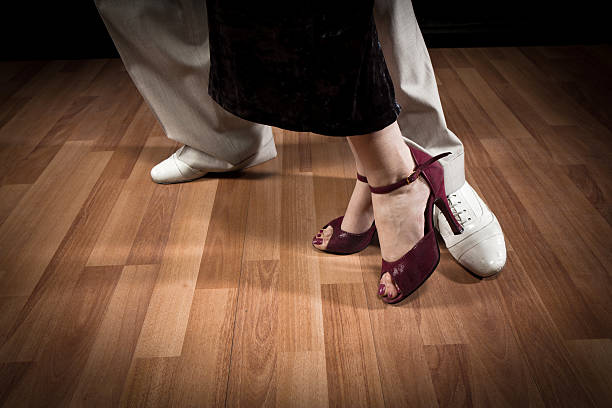 Male and female couple doing the steps of a Tango dance stock photo