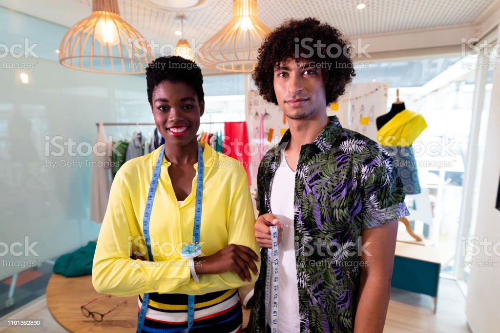 Male And Female Fashion Designer Standing Together In Design Studio Stock Photo Download Image Now Istock