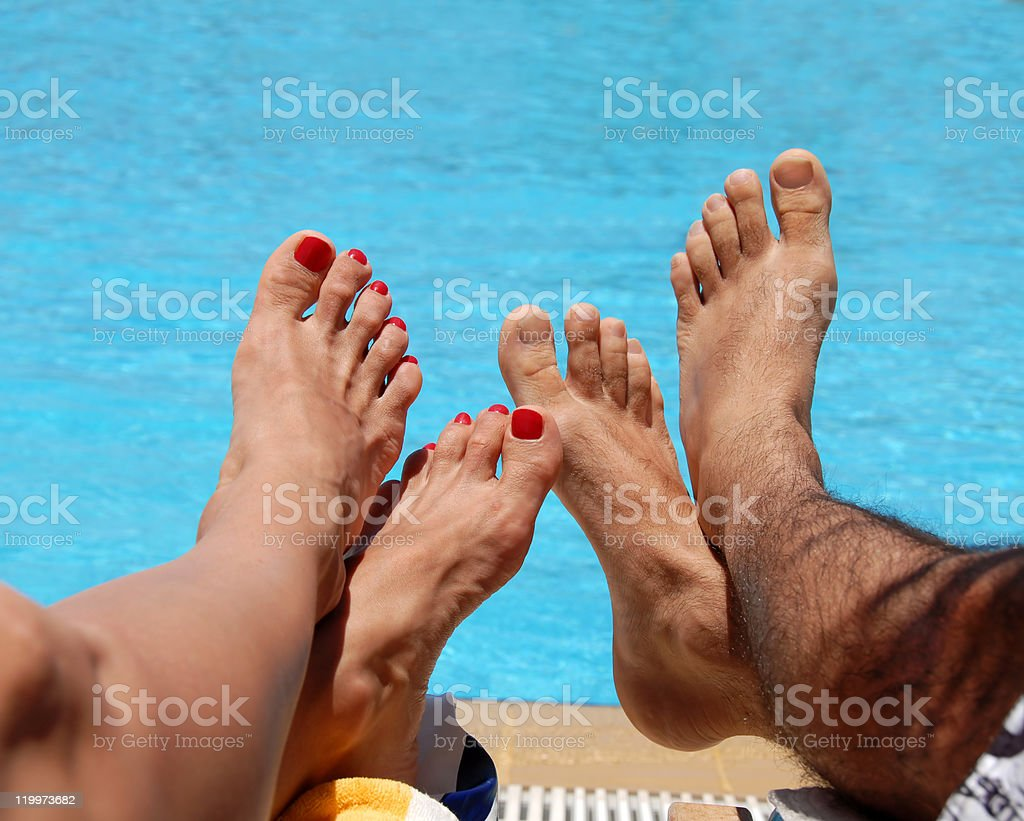 Male and female feet royalty-free stock photo