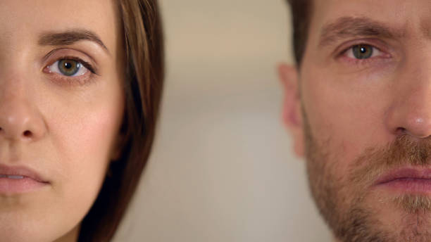 Male and female half face looking into camera, gender equality, opinion poll Male and female half face looking into camera, gender equality, opinion poll, stock footage real couples making love stock pictures, royalty-free photos & images