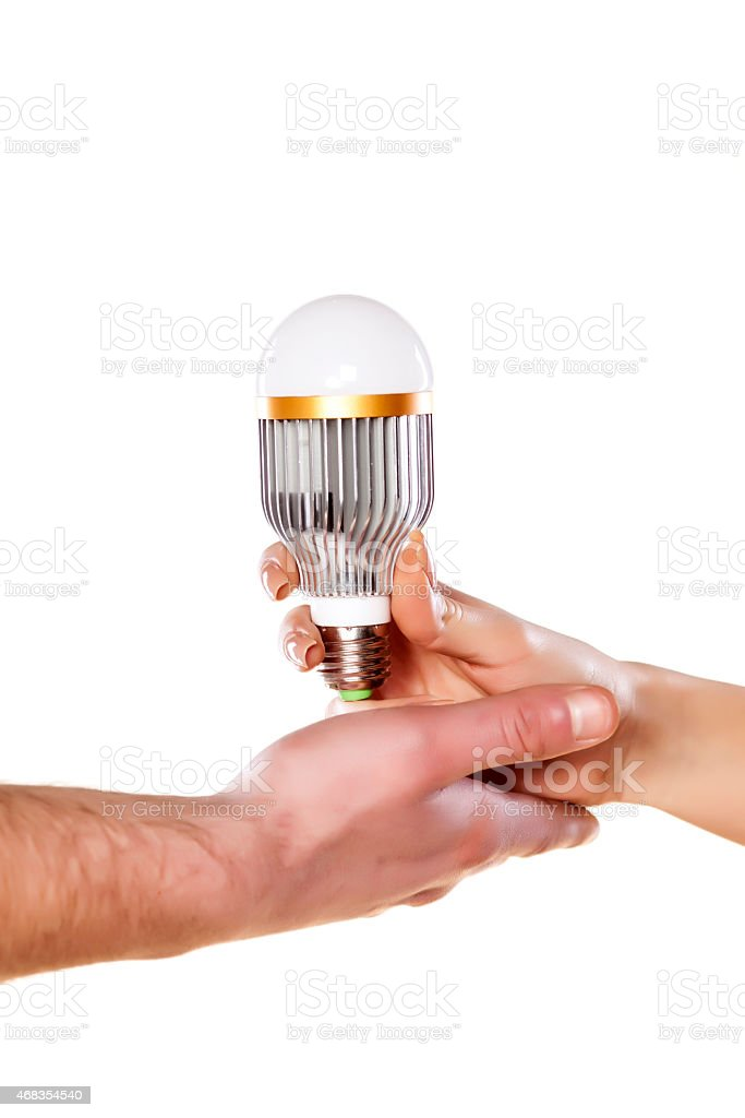 male and female hand holding LED royalty-free stock photo