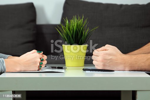 istock Male and female hands are folded opposite each other, close-up. Family quarrel, showdown, property division, divorce agreement 1135450836
