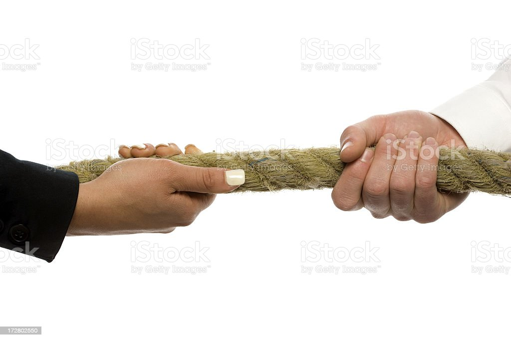 Male and female hands grasping rope. Tug-O-War. stock photo