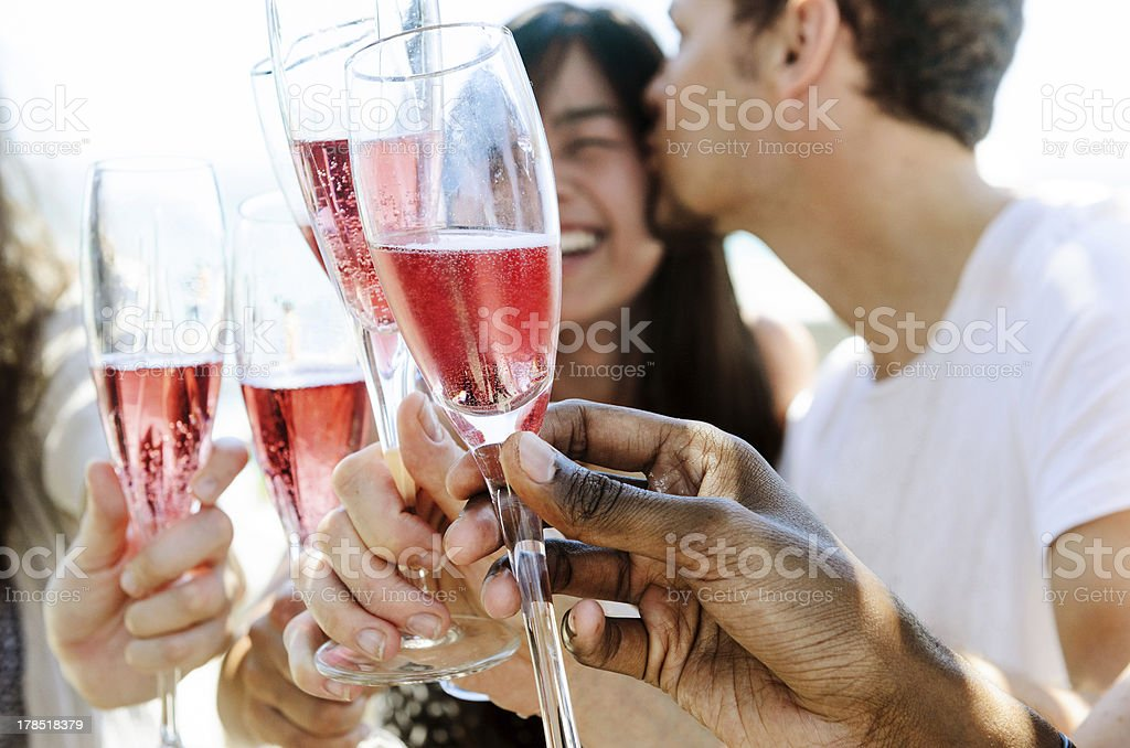 Male and female hands making a toast with celebratory drinks stock photo