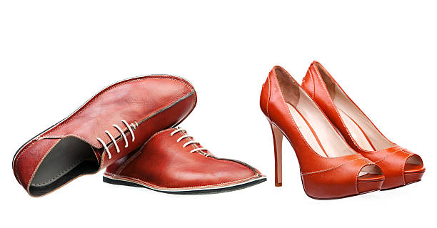 Male and female leather shoes isolated over white stock photo