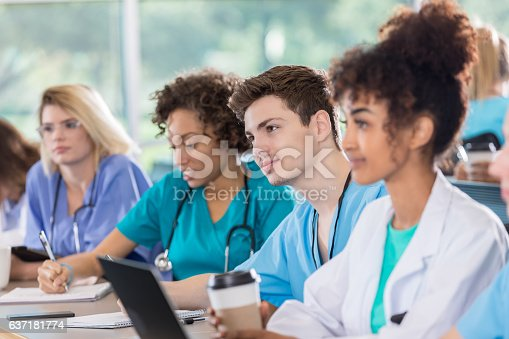 istock Male and female medical students in class 637181774