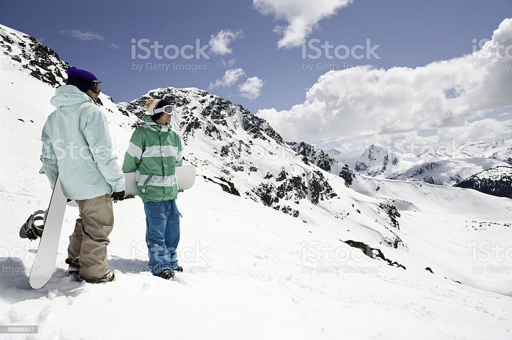 male and female snowboarders royalty-free stock photo
