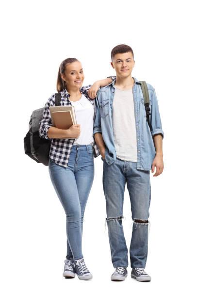 male and female student standing and smiling - compagni scuola foto e immagini stock