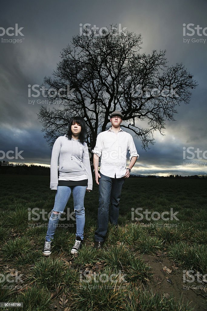 Male and Female Sunset Sky Tree Portrait royalty-free stock photo