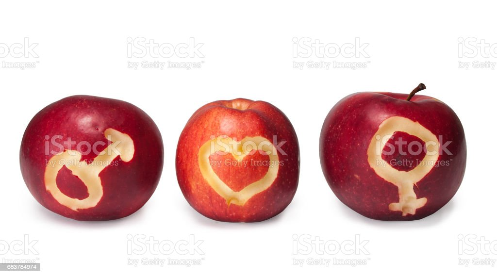 Male and female symbols carved on apples stock photo
