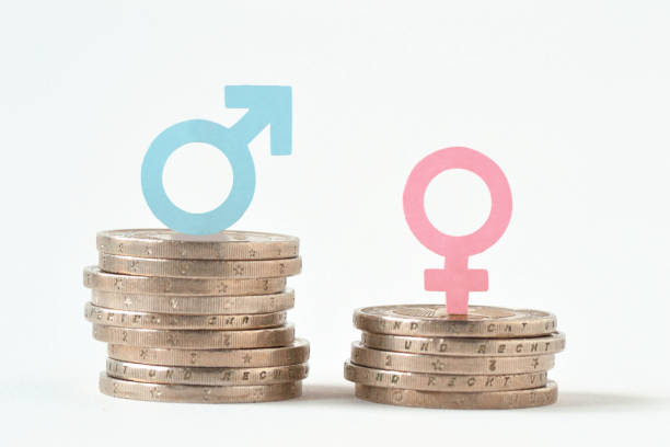 Male and female symbols on piles of coins - Gender pay equality concept Male and female symbols on piles of coins - Gender pay equality concept women's rights stock pictures, royalty-free photos & images