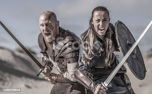 istock Male and female viking warrior couple in wild highland countryside 1089028844