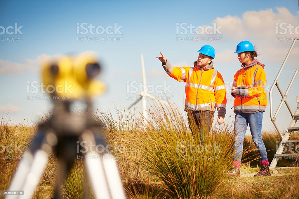 male and female windfarm engineers stock photo