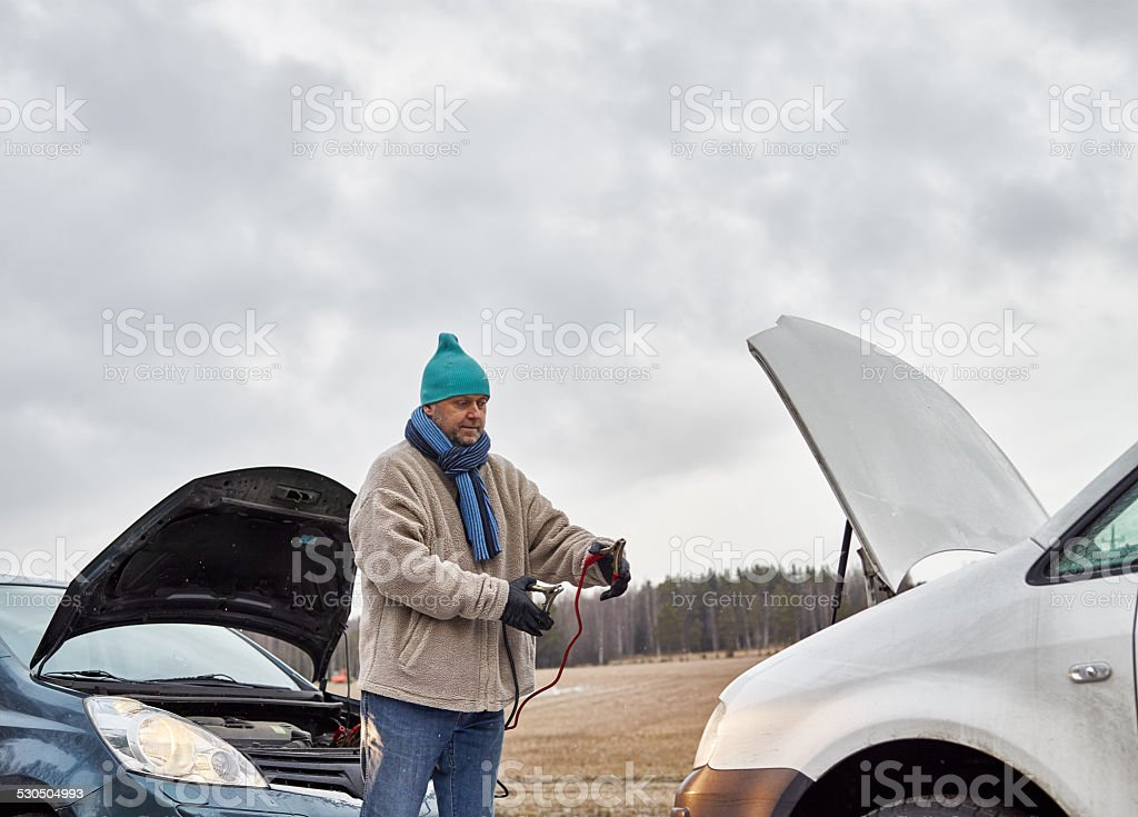 Male and jumper cables stock photo