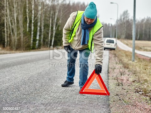 482803237istockphoto Male and warning triangle 530502437