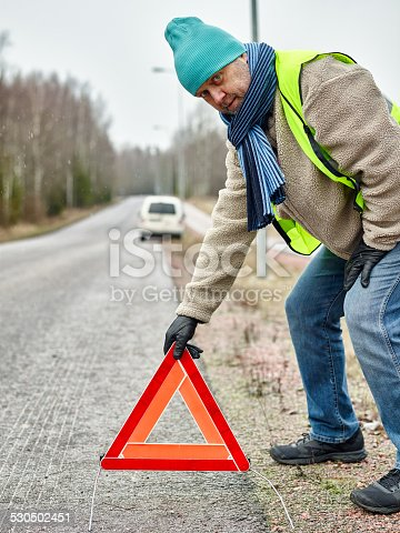 482803237istockphoto Male and warning triangle 530502451