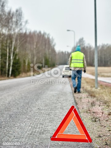 482803237istockphoto Male and warning triangle 530502453