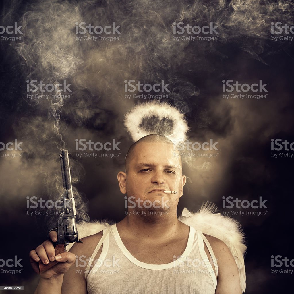 male angel with smoking colt stock photo