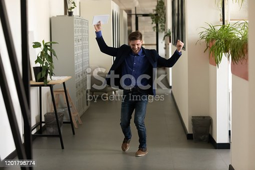 istock Male applicant after job interview feels happy got new work 1201798774