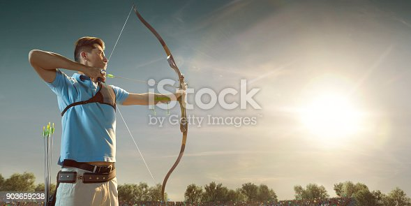 istock Male archer shooting with the longbow at sunset 903659238