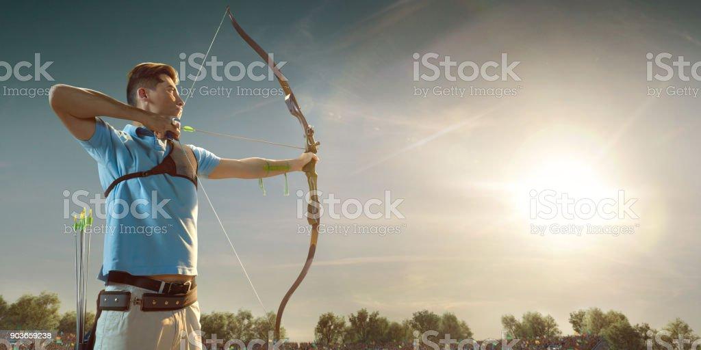Männliche Bogenschützen schießen mit dem Langbogen bei Sonnenuntergang – Foto