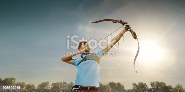 istock Male archer shooting with the longbow at sunset 903659246