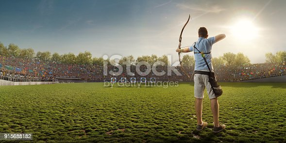 istock Male archer shooting with the longbow at sunset 915688182