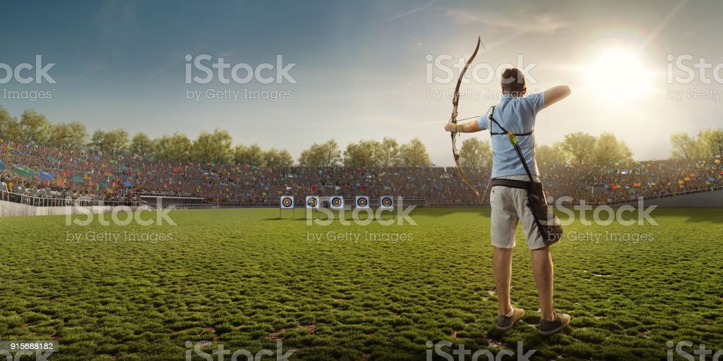 Male archer shooting with the longbow at sunset stock photo