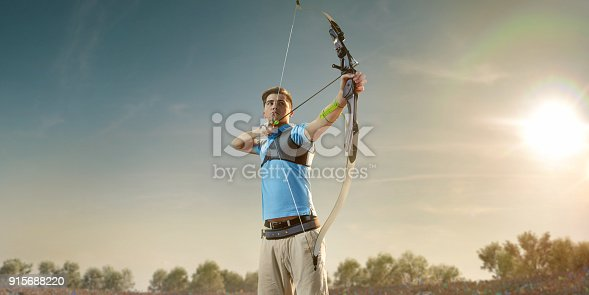 istock Male archer shooting with the longbow at sunset 915688220