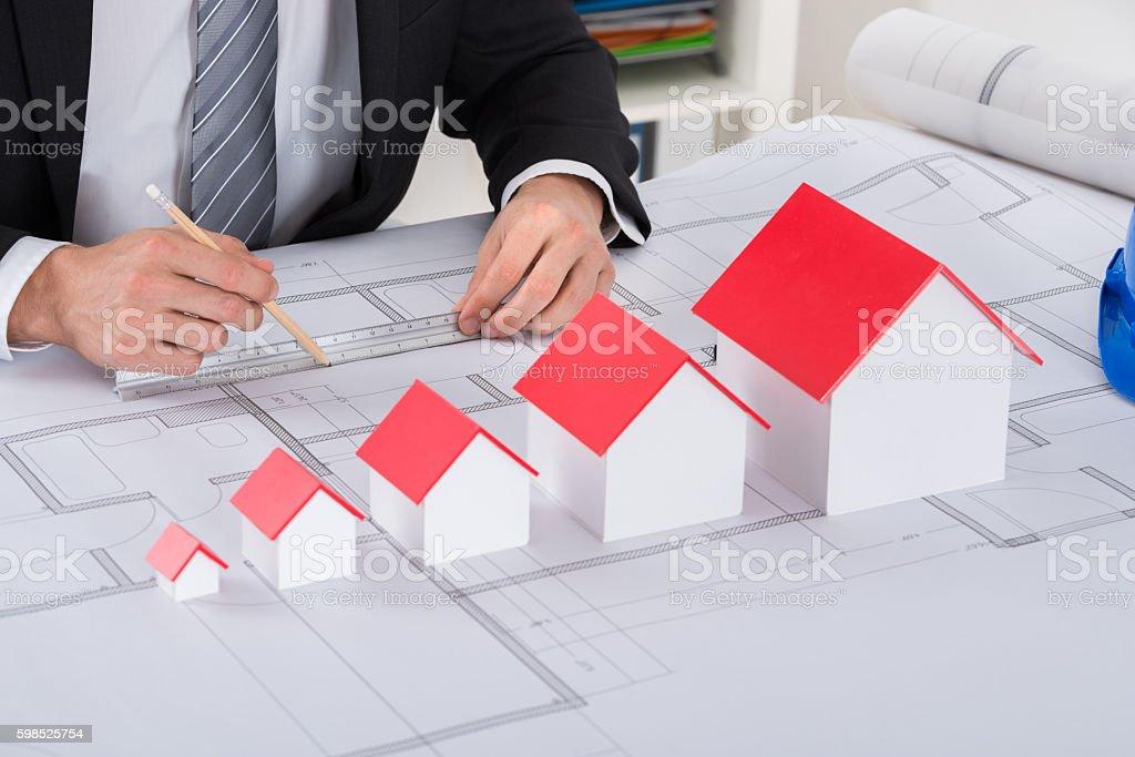 Male Architect Hand Working On Blueprint stock photo
