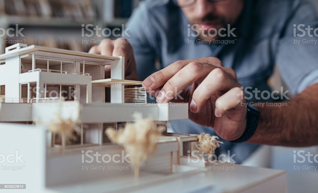 Male architect hands making model house stock photo