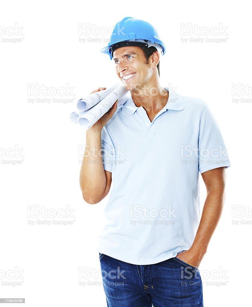 Male architect holding blueprints and smiling royalty-free stock photo