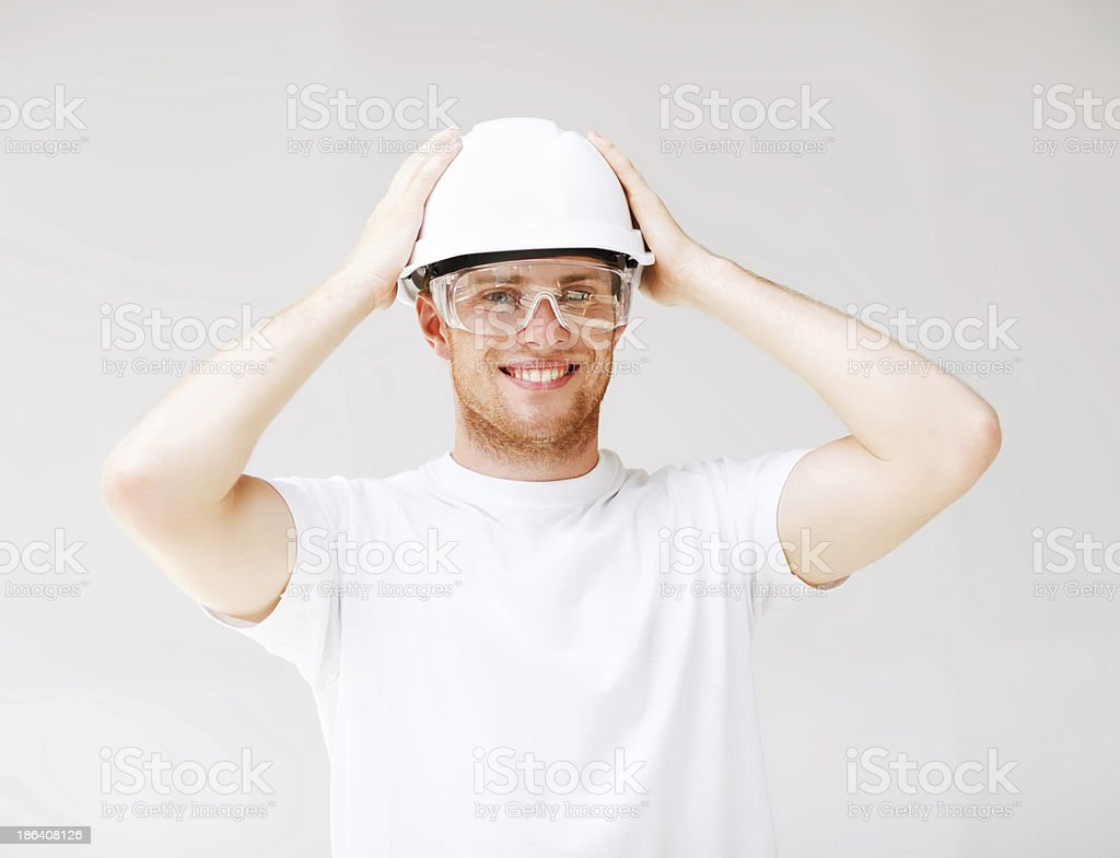 male architect in helmet with safety glasses royalty-free stock photo