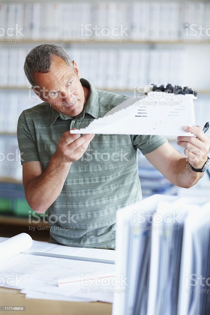 Male architect looking at a model building royalty-free stock photo