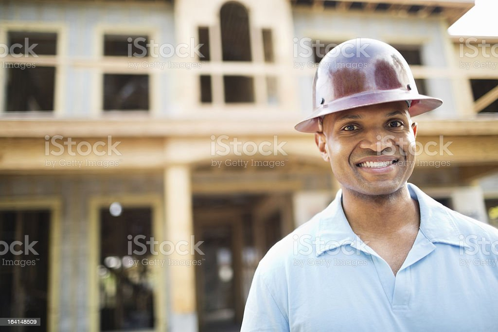 Male Architect Standing In Front Of House royalty-free stock photo