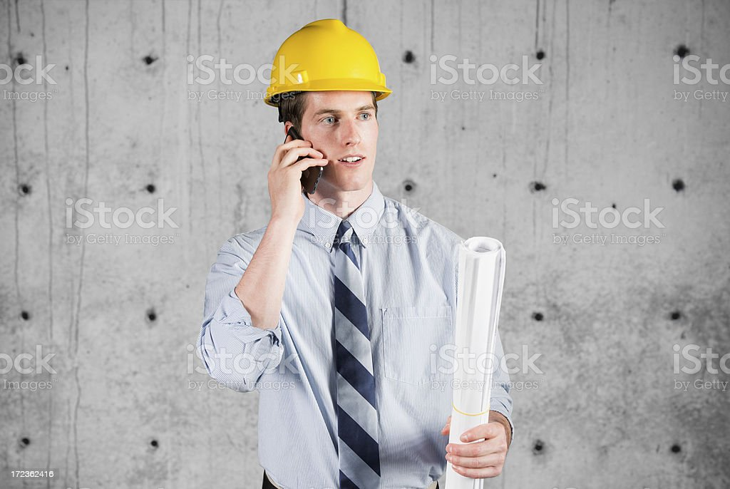 Male architect talking on a mobile phone royalty-free stock photo