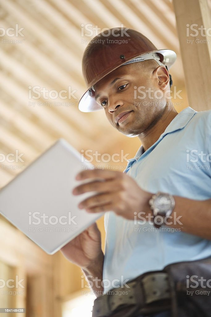 Male Architect Using Digital Tablet At Construction Site royalty-free stock photo