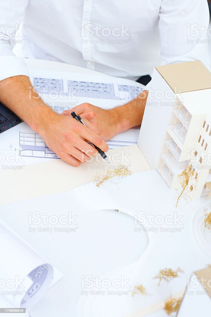 Male architect working on blueprint royalty-free stock photo