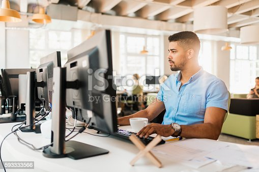 istock Male architect works on a project 593333566