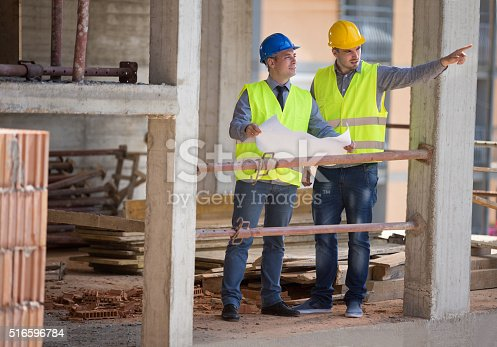 516607254istockphoto Male architects show building place to colleague 516596784