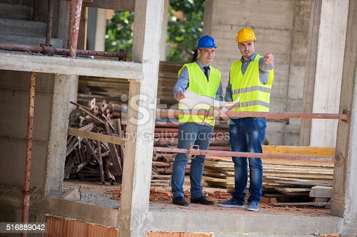 516607254 istock photo Male architects show building place to colleague 516889042