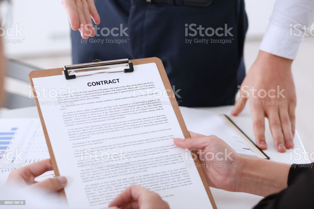 Male arm in shirt offer contract form on clipboard stock photo