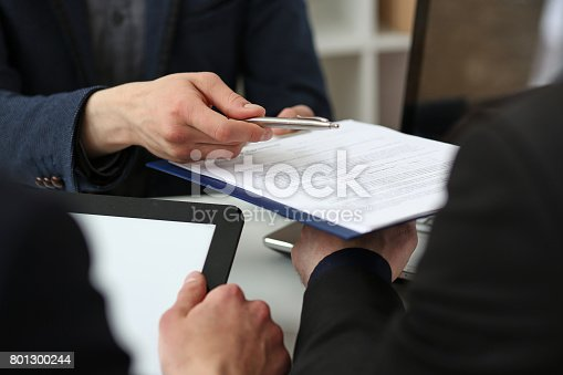 863148614istockphoto Male arm in suit offer contract form on clipboard pad 801300244
