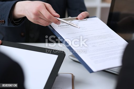 863148614istockphoto Male arm in suit offer contract form on clipboard pad 808396106