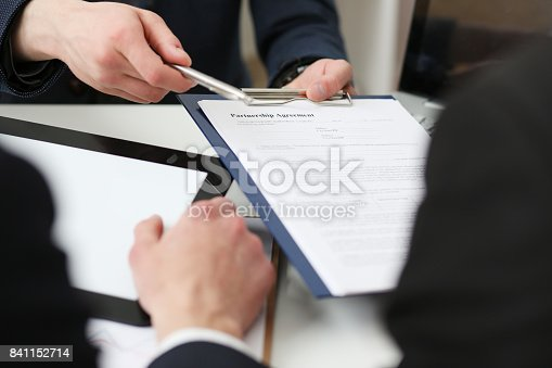 863148614istockphoto Male arm in suit offer contract form on clipboard pad 841152714