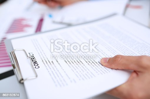 863148614istockphoto Male arm in suit offer contract form on clipboard pad 863152874